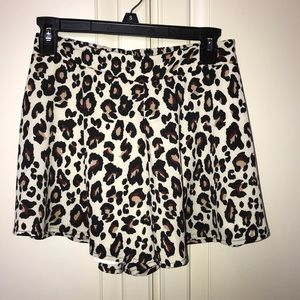 Cheetah shorts with maroon accent.